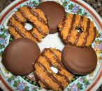 A platefull of Samoas and peanut butter Tagalongs.