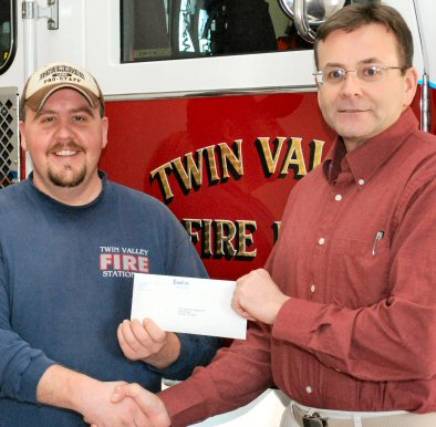 Twin Valley Fire Company Assistant Chief Jeff Cook, left, receives a check from Jeff Dean, Limerick's emergency preparedness off-site coordinator.