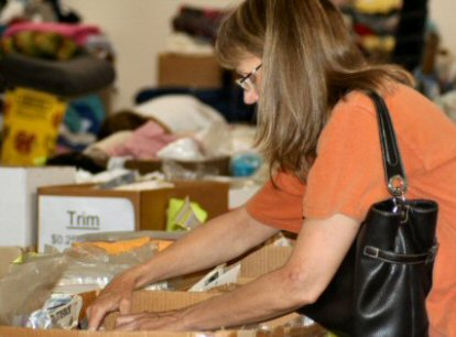 An eager customer browses through sewing patterns at the annual 4-H Fabric Sale. The fund-raising event was expected to bring in about $4,000 to benefit youth programs.