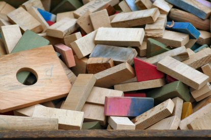 A box of a child's wooden blocks, waiting to be played with, between Green Lane and Red Hill.